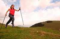 Woman running, nordic walking, Kampenwand, Chiemgau, Upper Bavaria, Bavaria, Germany, Europe