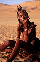 Himba woman smoking a traditional pipe, Kunene region, Namibia, Kaokoland