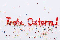 Words written in red writing icing with sprinkles