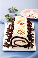 Chocolate roll with cream filling and grated chocolate