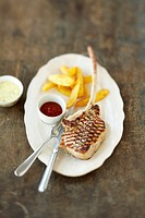 Grilled veal chop with chips, home_made ketchup