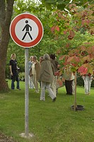 No trespassing. People behind a prohibition sign, Germany, Saarland, Botanischer Garten