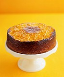 Orange almond cake on a cake stand