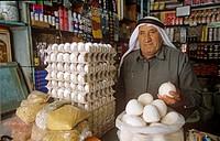 Vendor selling jameed dry, salted goat´s milk yoghurt, Jordan