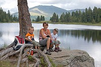 Woman and two children at the Gruensee Lake, Turracher Hoehe, Nockberge Mountains, Carinthia, Austria, Europe