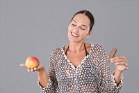 Woman with an apple and a chocolate snack