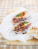 Chicken breast with Parma ham in grilling basket