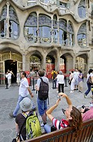 People in front of the Batllo House by Gaudi, Barcelona. Catalonia, Spain