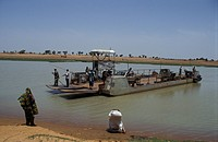 Ferry crossing the Niger river to reach DjennÚ town, Mali, Djenne
