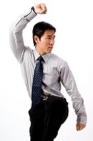 A young asian businessman in a tai chi pose