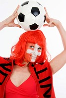 woman as Switzerland fan, with fan scarf and football