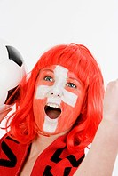 woman as Switzerland fan, with a football
