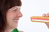 brown_haired woman with cream slice, smiling