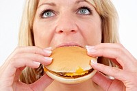 blond woman eats a burger