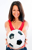young cute woman in red top with soccer ball, holding the ball into the camera