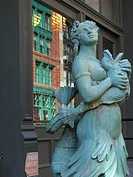 Figure of naked mermaid is standing in front of a building in Tribeca, USA, Manhattan, New York