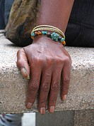 hand of a dark_skinned woman with bracelets, USA, Manhattan, Harlem, New York