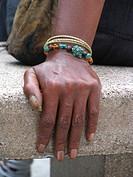 hand of a dark_skinned woman with bracelets, USA, Manhattan, Harlem, New York