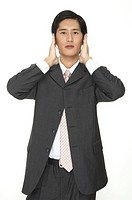 A smart asian businessman, having headache