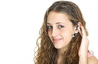 A pretty female talks on a hands_free wireless headset