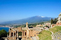 Ruins of a theatre with a mountain in the background, Greek Theatre, Mt Etna, Taormina, Sicily, Italy