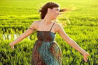 Beautiful brunette indian young woman in the green rice fields meadow