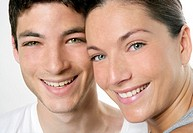 Beautiful young couple closeup portrait, two faces over white