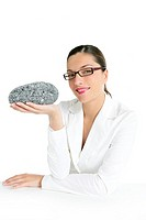 Businesswoman concept thinking with gray stone in ther hand