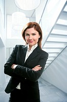 Businesswoman portrait at home in modern white stairway