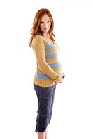 Beautiful pregnant redhead woman fashion white background