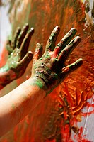 Children artist hands painting colorful with her fingers