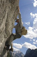 historic mountain climber climbing at a rock wall, Austria, Gosautal