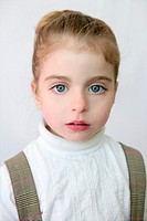Beautiful preschooler blue eyes portrat with school dress