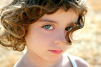 Beautiful little girl portrait outdoor looking to camera