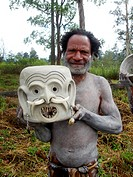 man with clay mask, Papua New Guinea