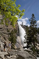 Hikers below NEVADA FALLS which drops 594 feet as it heads into the YOSEMITE VALLEY, USA, California, Yosemite National Park