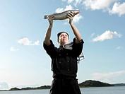 Chef holding fish