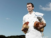 Chef holding hens
