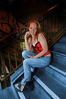 young woman in stairwell, Germany, North Rhine_Westphalia, Koeln