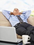 Tired businessman relaxing on a couch