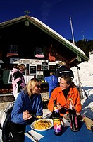 Guests in front of the Finstermuenzalm Mountain Hut on the Bayernhang ski run, Brauneck, Bayrische Alpen or Bavarian Alps, Bavaria, Germany, Europe