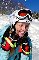 Pretty female skier wearing a helmet