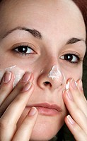 woman with cream on her face