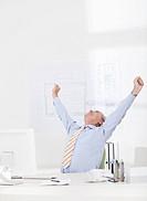 Man celebrating, stretching arms