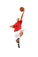 Confident, athletic man in basketball uniform jumping in mid_air about to throw the ball