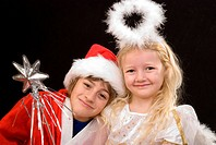 children as Santa Claus and christ child