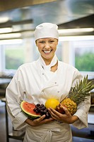 Portrait of a female chef with fruit