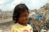 Sad girl rummaging through rubbish at the Stung Meanchey Municipal Garbage Dump in the south of Cambodia's capital Phnom Penh where she lives with man...