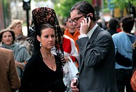 couple, woman with a traditional headdress and man with mobile phone, Spain, Andalusia, Sevilla