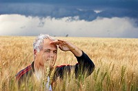 Storm chaser Tim Marshall in a prairie field in western Kansas, USA, June 10, 2009